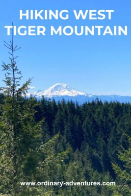 Mt Rainier in the distance on a sunny day. There is a forested hillside in the foreground. Text reads: Hiking west tiger mountain
