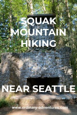 A stone fireplace in the forest. Text reads: Squak Mountain hiking near seattle