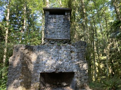 A stone fireplace in the forest, a feature of Squak Mountain hiking